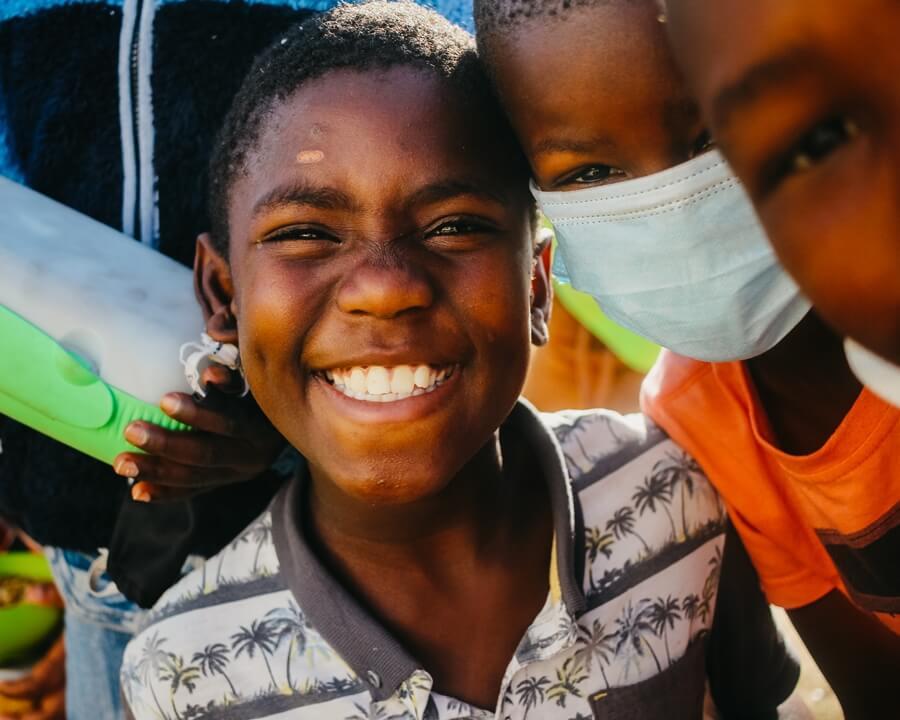 Child smiling at Kwazakhele soup kitchen