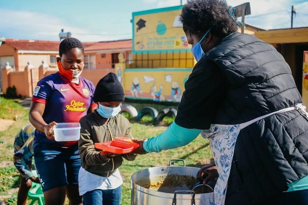 Children receiving food at Kwazakhele soup kitchen