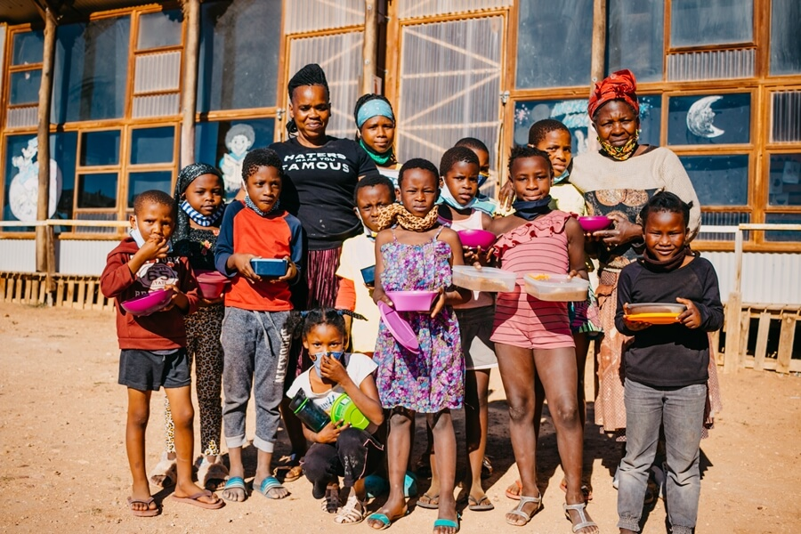 Children with their lunch at Joe Slovo soup kitchen