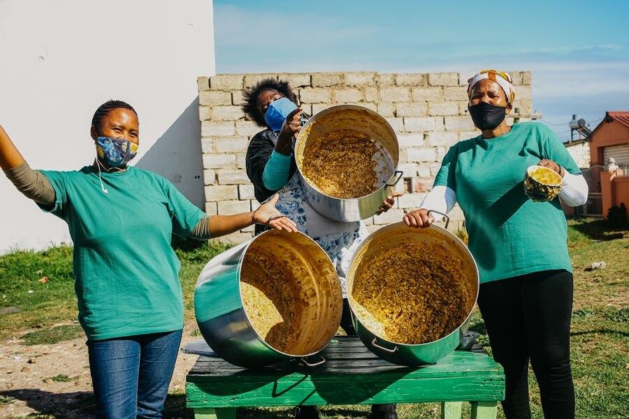 Ladies celebrating at Kwazakhele soup kitchen